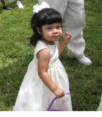 Toddler Alba collecting eggs at Easter egg hunt in Pompano Florida.